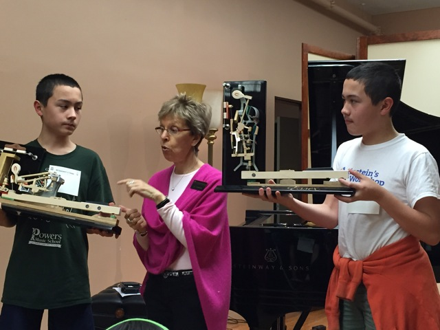 Students learn the difference between the action parts of a grand and upright piano.