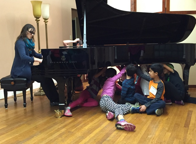 Student detectives get an unforgettable experience listening to teacher Victoria Suchodoloski play on a Steinway grand, under the piano!