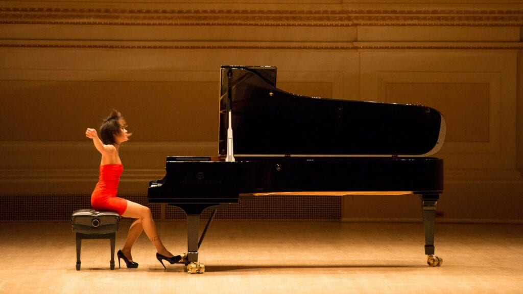 Photo of Chinese concert pianist and Steinway Artist Yuja Wang at her Model D Steinway.
