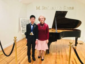 Photo of Boston-area piano instructor with young student.