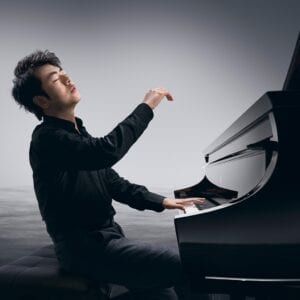 Photo of Steinway Artist Lang Lang playing a Model D.