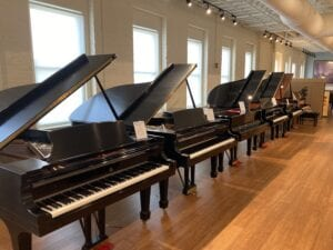 A row of new Steinway grands at M. Steinert & Sons in Boston