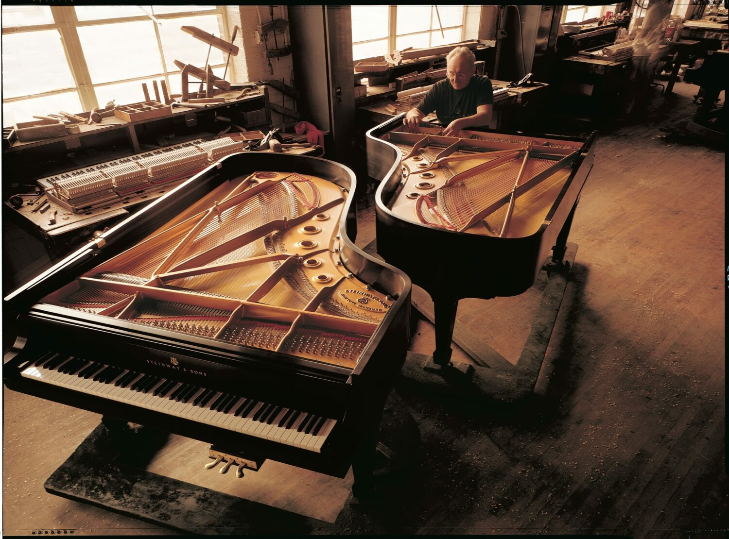 Photo of two Steinway grand pianos in factory