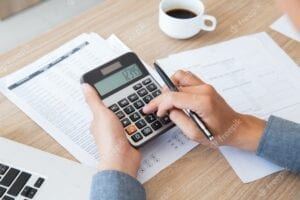 Photo of man calculating a payment