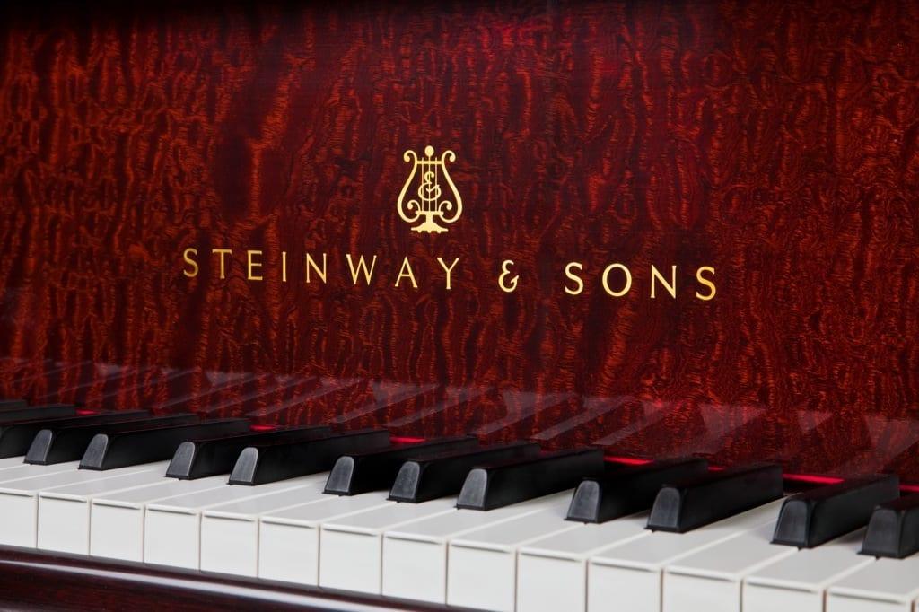 Photo of Steinway & Sons logo on mahogany grand piano