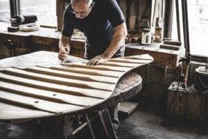 Photo of Steinway craftsman working on soundboard