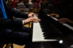 Photo of concert pianist's hands playing a Steinway concert grand.