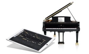 Photo of iPad interface with Spirio piano in background