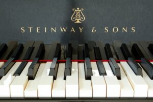 Photo of moving keys on a Steinway Spirio self-playing piano.