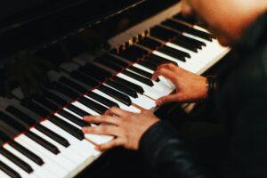 Photo of pianist playing Yamaha keyboard