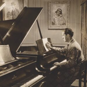 Photo of Jazz legend George Gershwin composing at his Steinway.