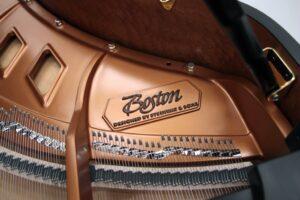 Photo of the interior of a Boston grand piano