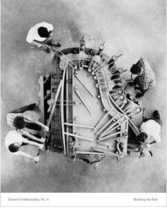 Aerial photo of Steinway craftspeople building a Hard Rock Maple rim for a grand piano.
